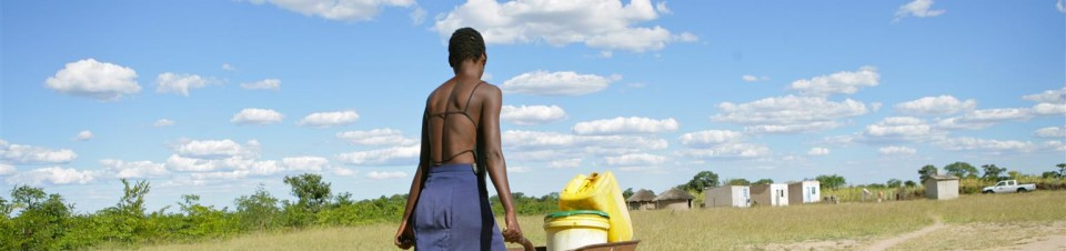 Talent 17 carries water from a borehole in the village of Zibanani, Mangwe district some 200 Kms south of Bulawayo the second largest city.