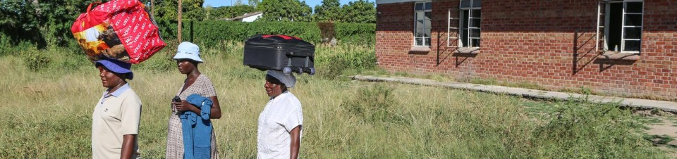 A pregnant woman, accompanied by family members, arrives at Chivi District Hospital, in Masvingo Province.