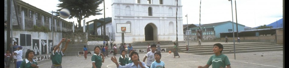 1993. Children, part of the Cakchiquel indigenous group, play basketball in the central plaza of the village of Santa Clara La Laguna.