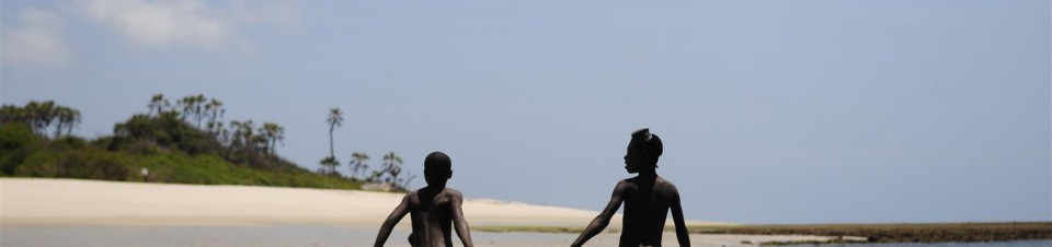Children walking back to the beach after playing and fishing over the weekend. Amani Beach, Dar Es Salaam.