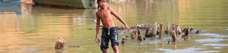 Orang Asli children swimming in the river in Peta Village, Johor
